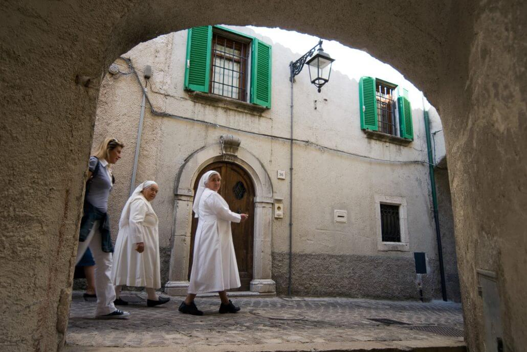 Abruzzo National Park, Italy, June 2008. 2 catholic nuns walk through the town. The Medieval Village of Barrea with its narow winding streets overlooks the lake. Photo by Frits Meyst / MeystPhoto.com