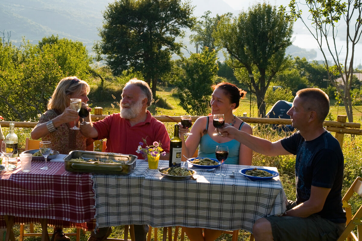 Pasetta enjoys a meal with his guests in Camping La Genziana, Abruzzo National Park